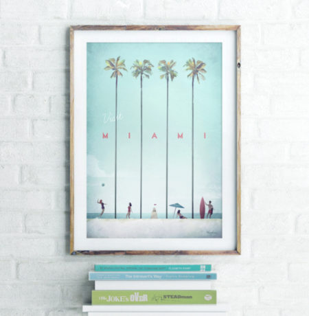 Miami Vintage Travel Poster Artwork in Wooden Frame. Interior shot of art print and book collection. Artwork by Henry Rivers