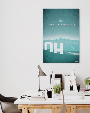 Vintage travel poster of Los Angeles in modern minimalist office interior. Large blue art print with Hollywood sign by Henry Rivers
