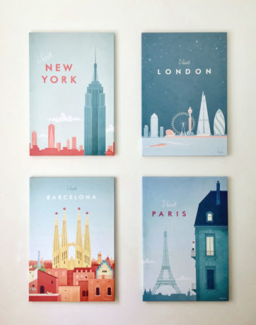 Collection of 4 vintage travel posters: In clockwise order from top left - New York, London, Paris and Barcelona. Modern travel poster illustrations by Henry Rivers