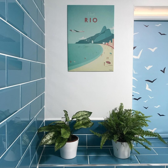 Rio travel poster by Henry Rivers. Wall art in bathroom interior.