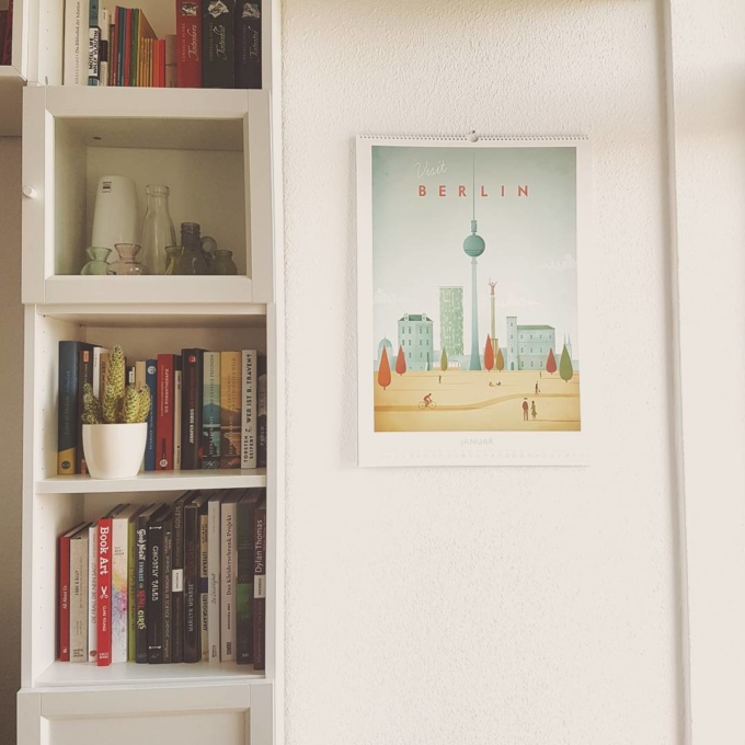 Berlin travel poster on a white wall by illustrator Henry Rivers