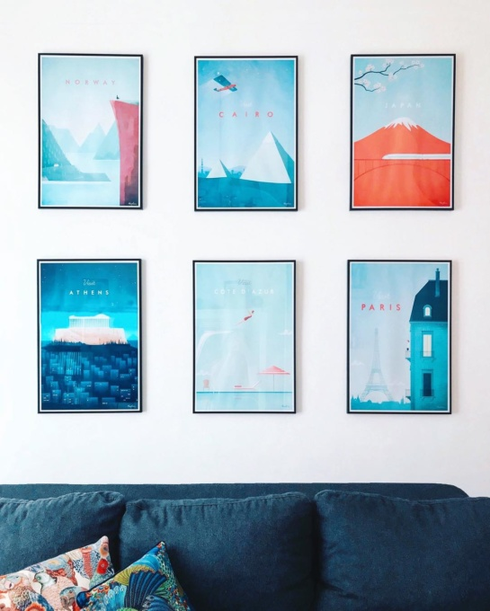 Collection of travel posters by artist Henry Rivers. Modern minimalist travel poster collection. White wall interior.