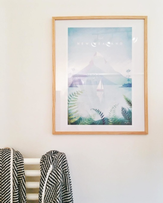 New Zealand travel poster by illustrator Henry Rivers. Framed New Zealand travel poster on white wall.