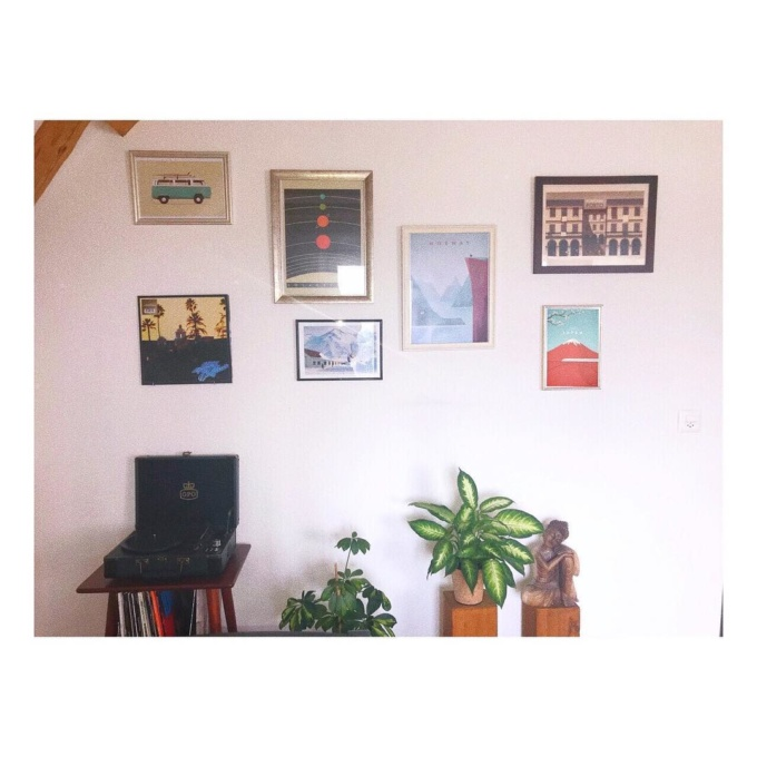 gallery wall with travel posters by international artist Henry Rivers
